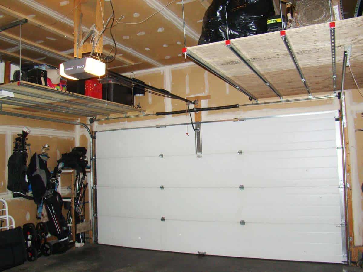 Convert wasted space over garage door